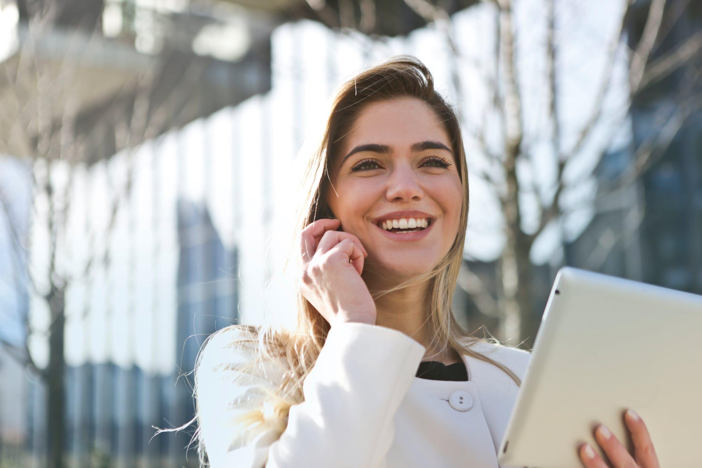 Smiling woman using ipad